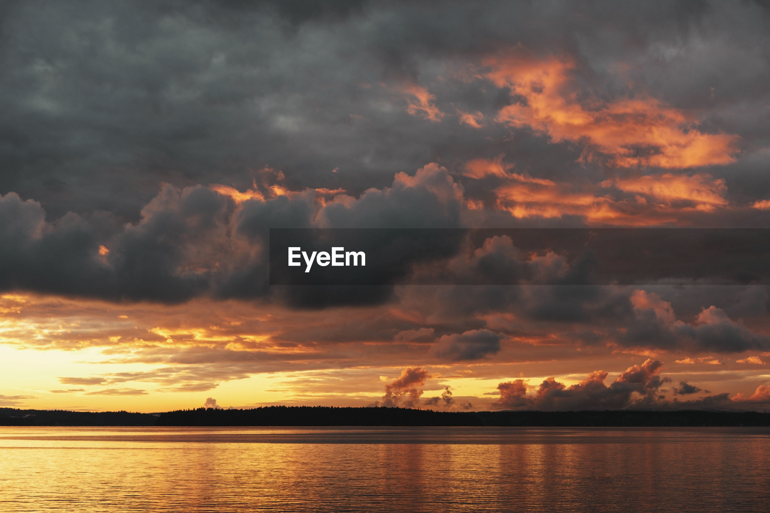 Dramatic fire sky sunset over sea.
