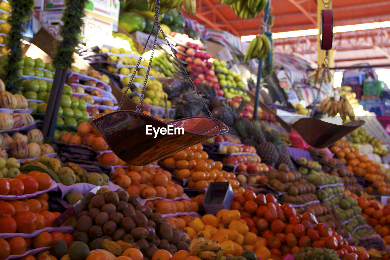 food, food and drink, healthy eating, market, fruit, choice, market stall, freshness, retail, variation, wellbeing, for sale, abundance, large group of objects, no people, day, vegetable, business, retail display, small business, outdoors, sale, consumerism, ripe, orange, street market