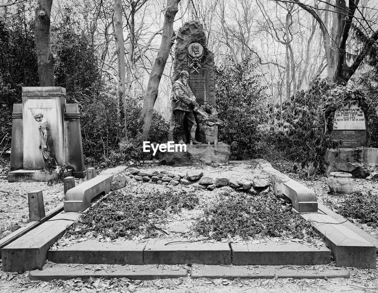 human representation, representation, statue, sculpture, male likeness, grave, art and craft, cemetery, plant, tree, memorial, day, creativity, no people, nature, architecture, solid, tombstone, religion, stone material, outdoors