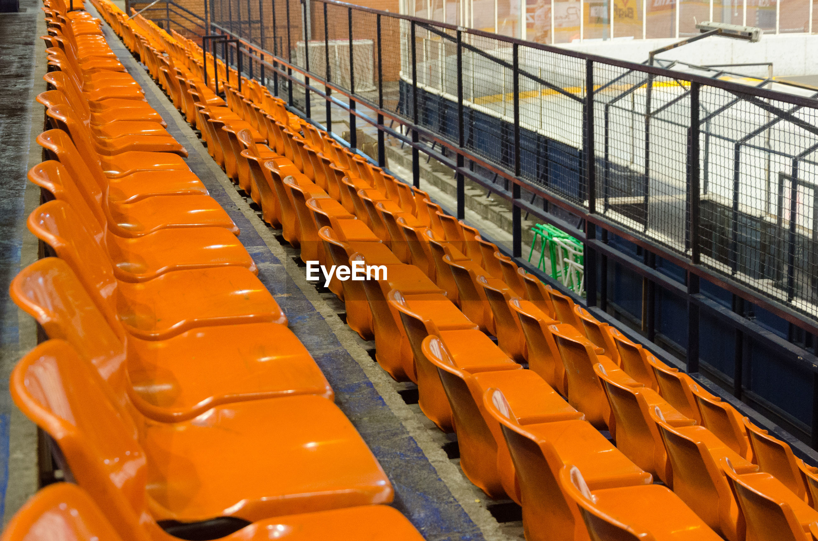 Empty orange seats at ice hockey stadium