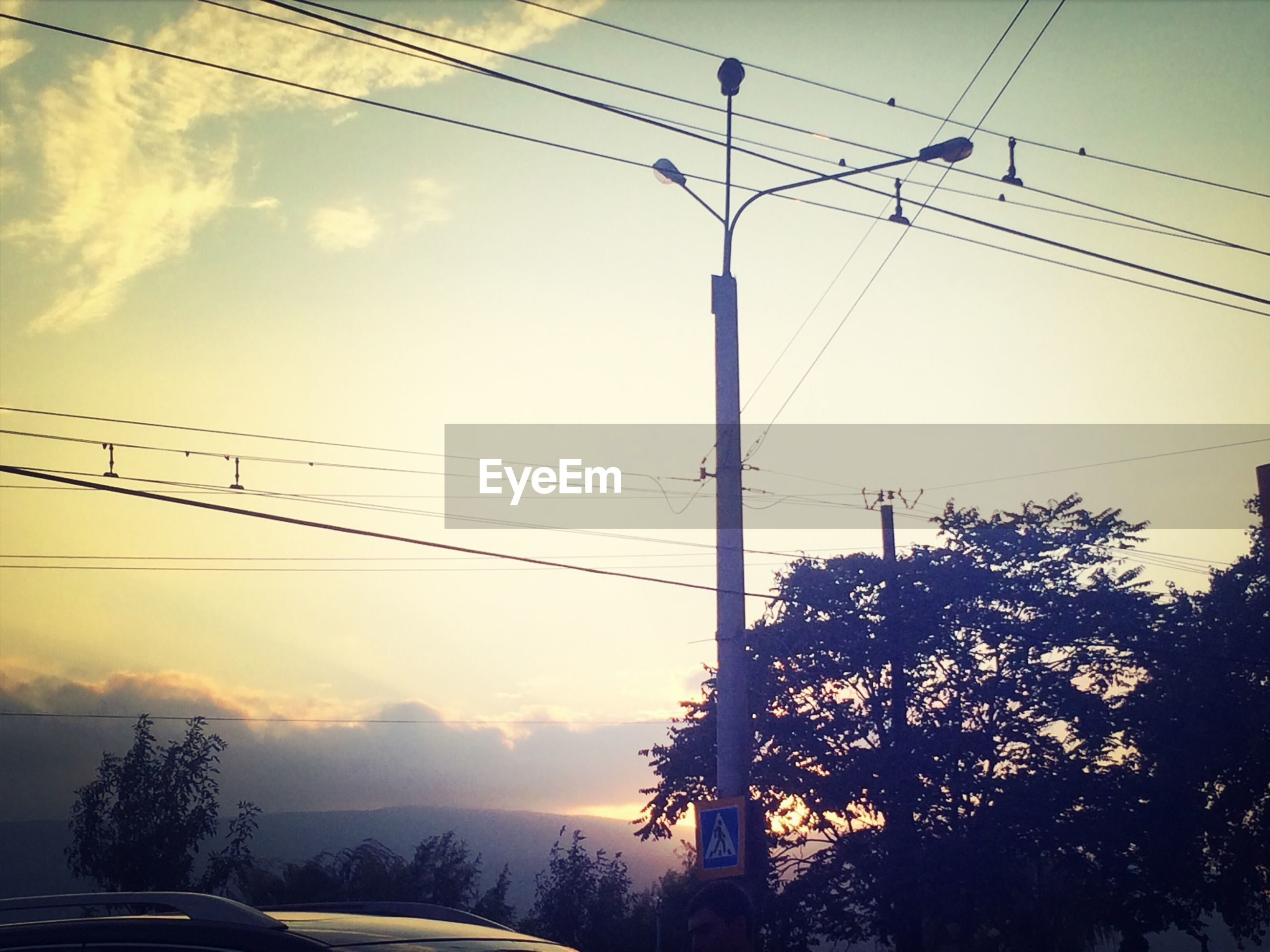 power line, electricity pylon, electricity, cable, power supply, connection, fuel and power generation, sky, power cable, technology, tree, low angle view, cloud - sky, overhead cable car, telephone line, telephone pole, transportation, nature, silhouette, outdoors