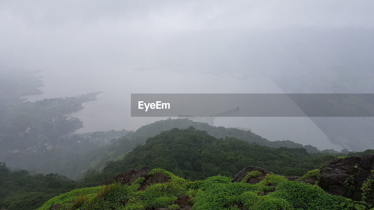 Scenic View Of Mountains Against Sky During Rainy Season