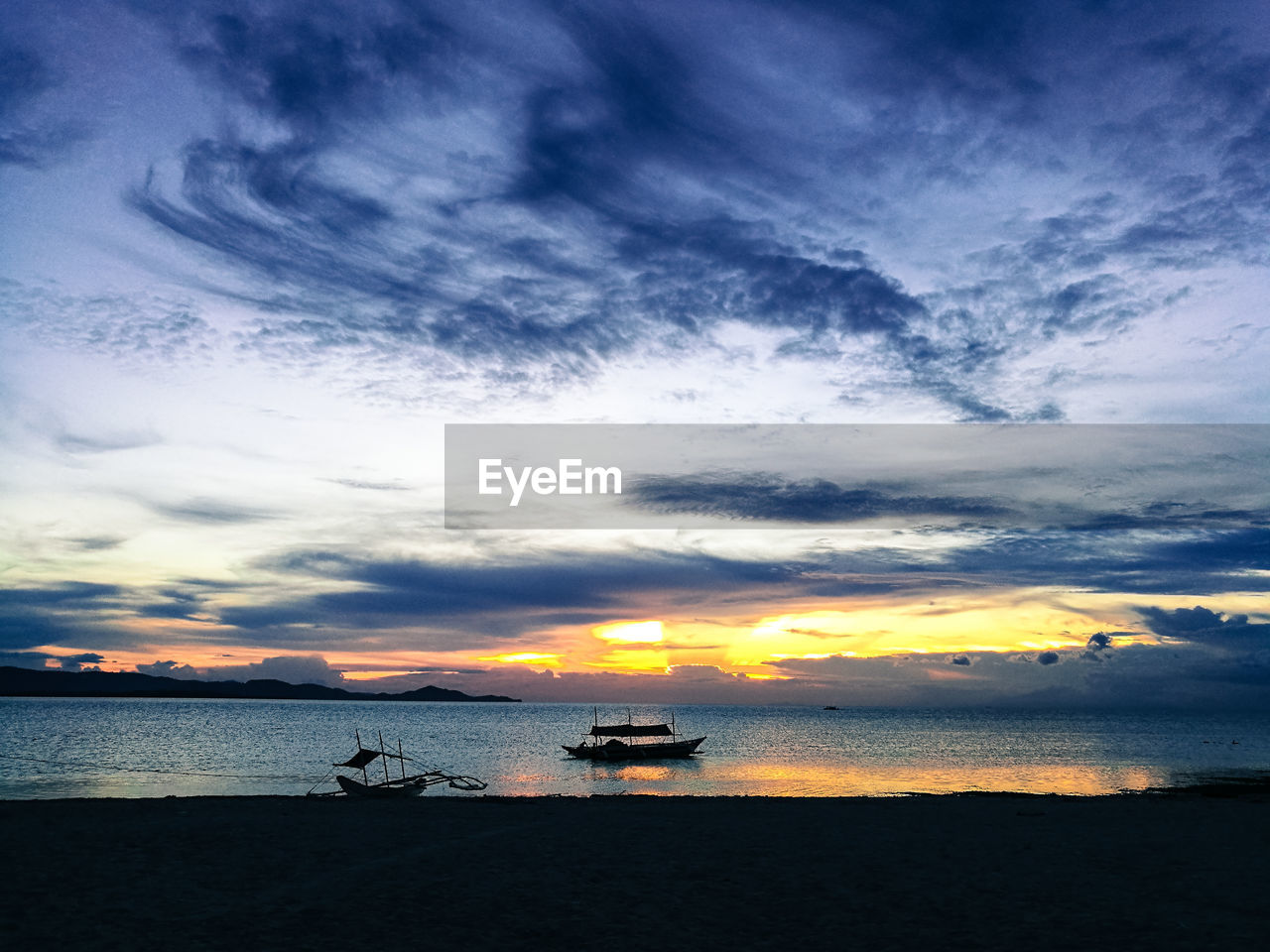water, sea, sunset, beauty in nature, sky, nature, scenics, nautical vessel, horizon over water, cloud - sky, tranquility, transportation, tranquil scene, beach, mode of transport, outdoors, silhouette, no people, jet boat, day