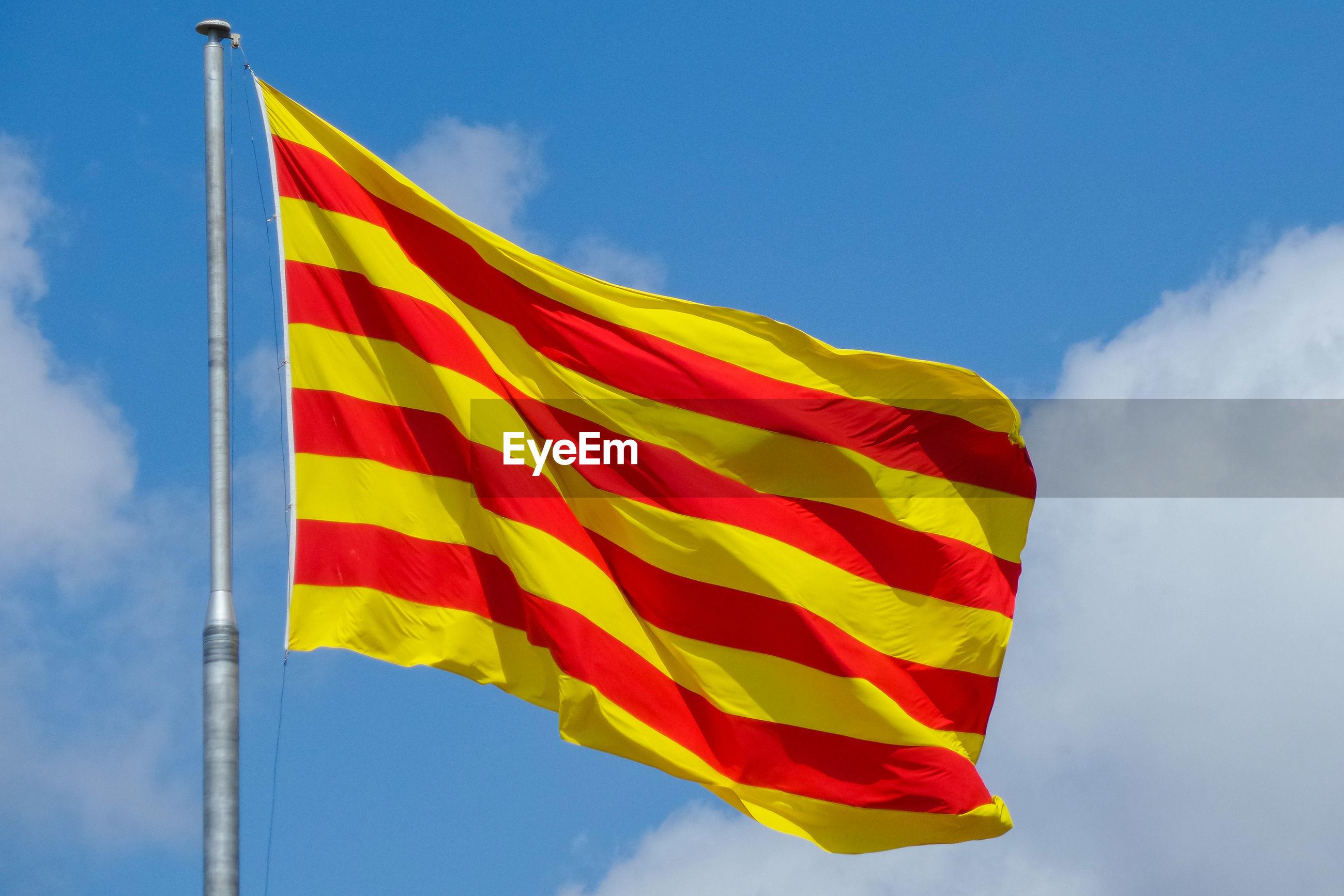 Catalan flag waving against sky