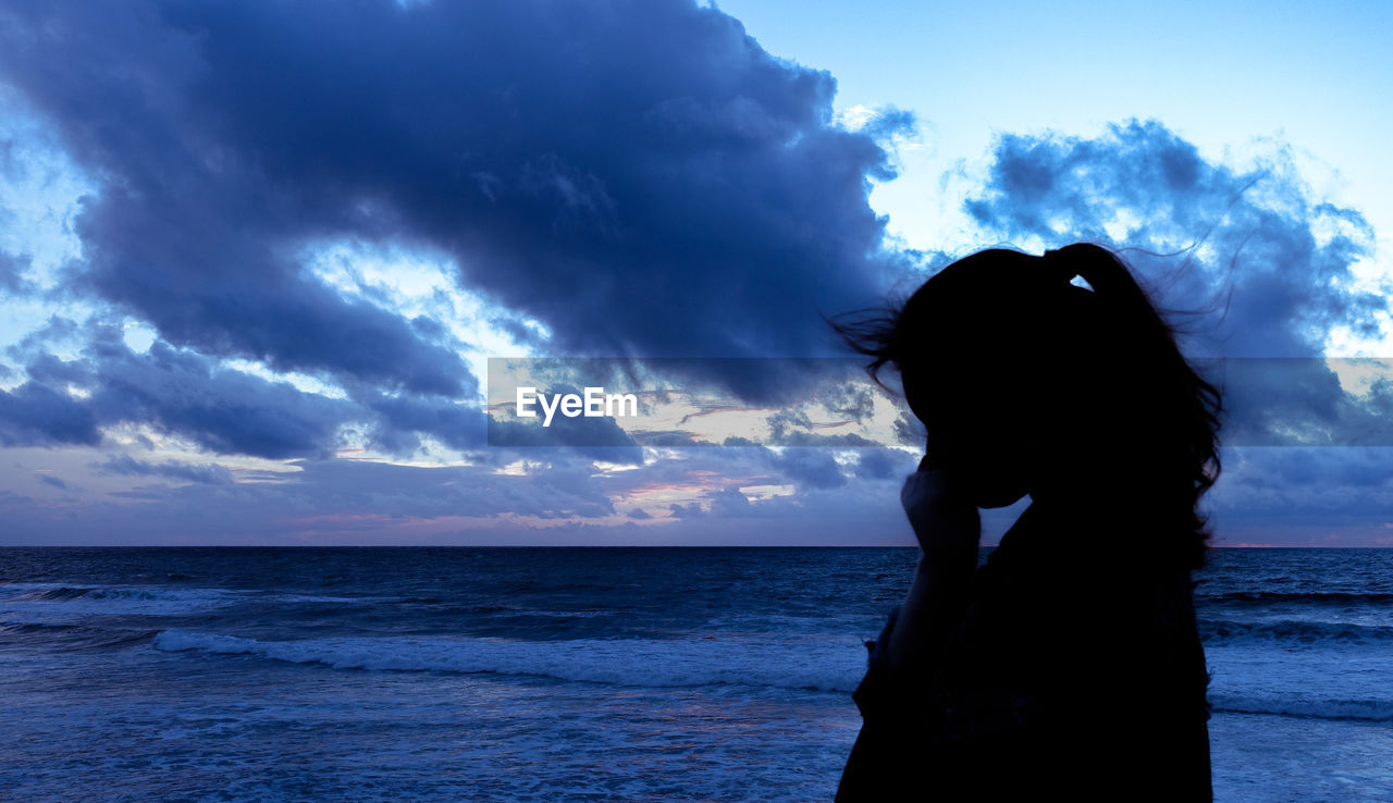sky, cloud - sky, sea, water, one person, horizon over water, women, horizon, real people, beauty in nature, scenics - nature, adult, nature, lifestyles, silhouette, leisure activity, beach, standing, outdoors, hairstyle
