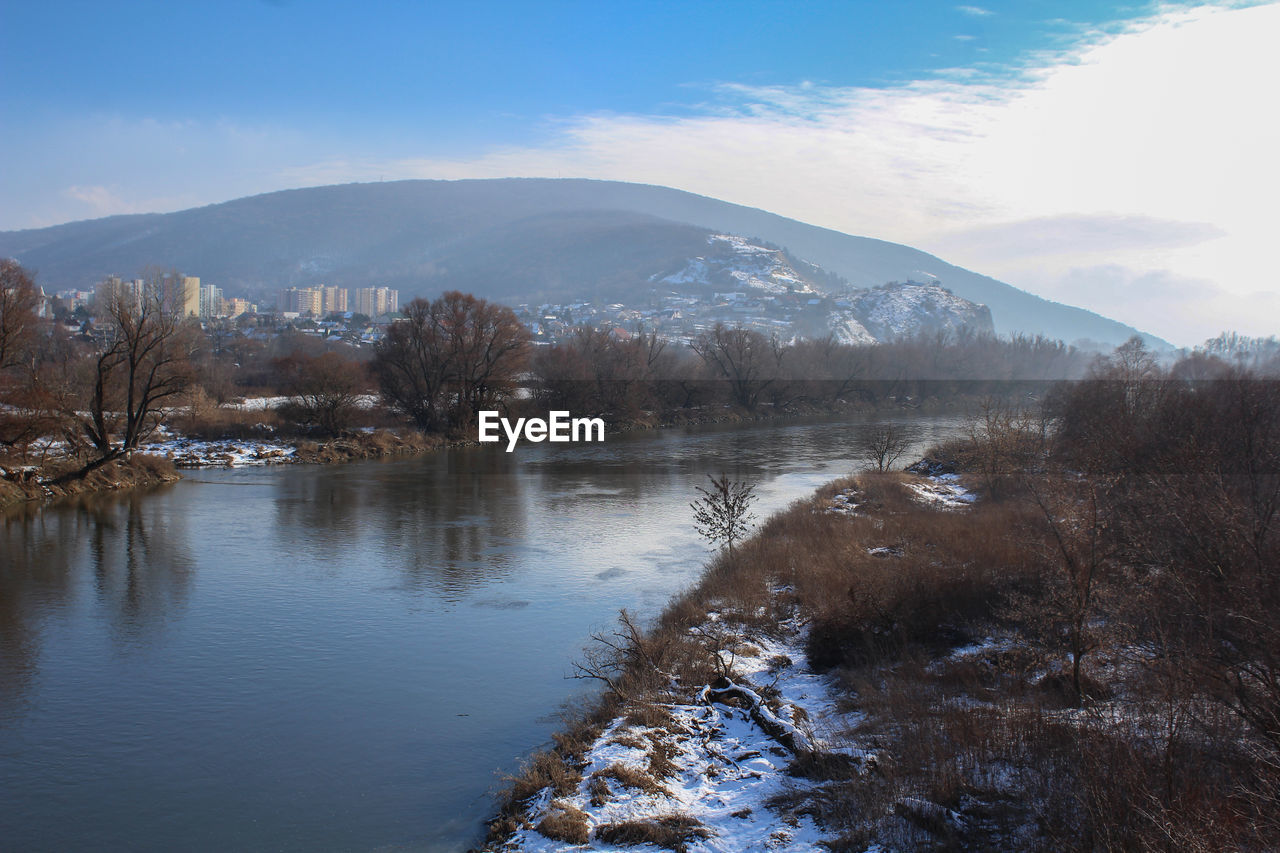 mountain, water, beauty in nature, sky, scenics - nature, tree, tranquil scene, tranquility, plant, nature, non-urban scene, no people, winter, cloud - sky, cold temperature, mountain range, lake, snow, outdoors, snowcapped mountain