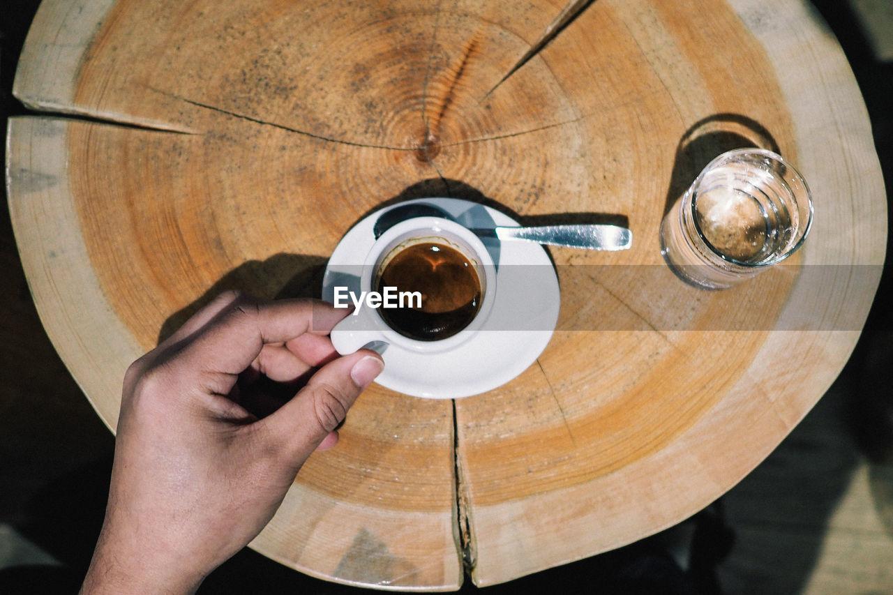 Cropped hand having espresso