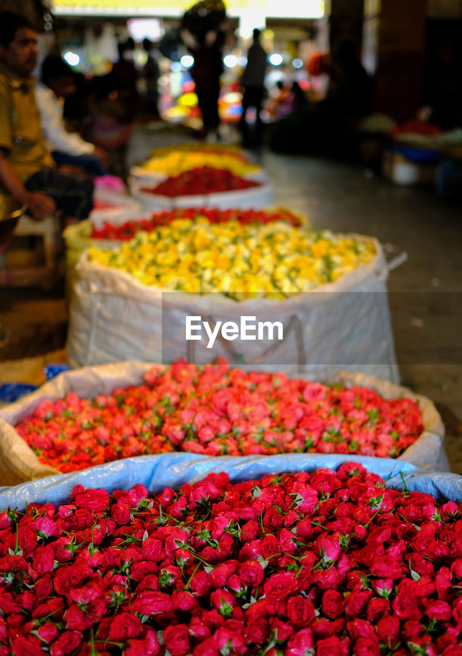 market, freshness, market stall, flower, incidental people, flowering plant, retail, for sale, food, food and drink, spice, choice, plant, abundance, day, red, business, arrangement, focus on foreground, variation, outdoors, flower market
