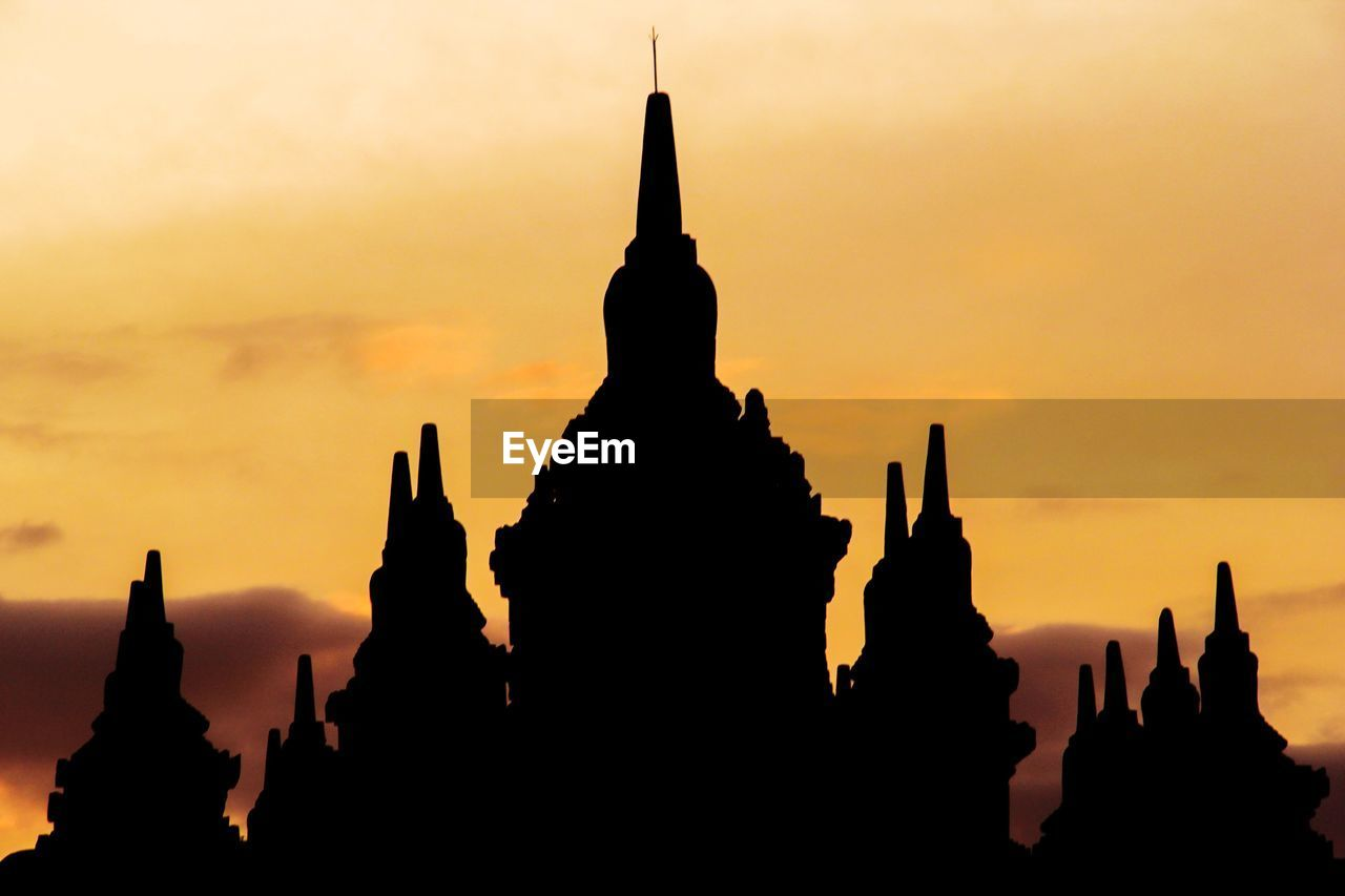 sky, silhouette, belief, architecture, religion, spirituality, place of worship, built structure, sunset, travel destinations, building exterior, tourism, building, travel, history, the past, no people, orange color, outdoors, ancient civilization, spire