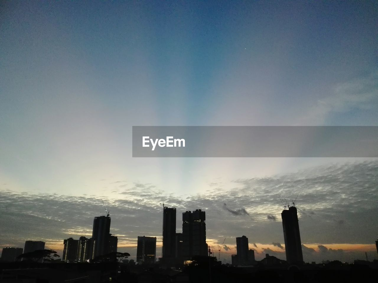 skyscraper, building exterior, architecture, built structure, city, sky, cityscape, sunset, modern, cloud - sky, no people, outdoors, urban skyline, nature, day