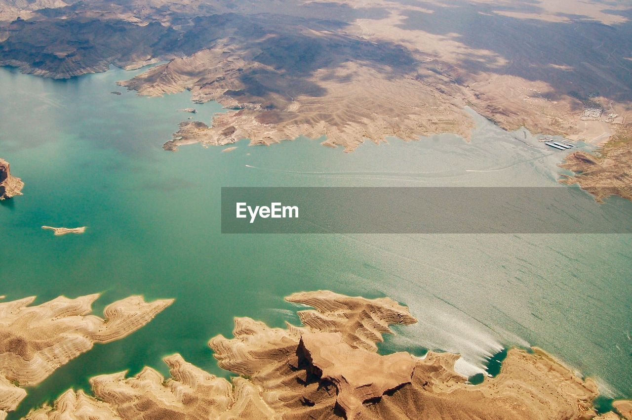 Aerial View Of Sea By Mountains