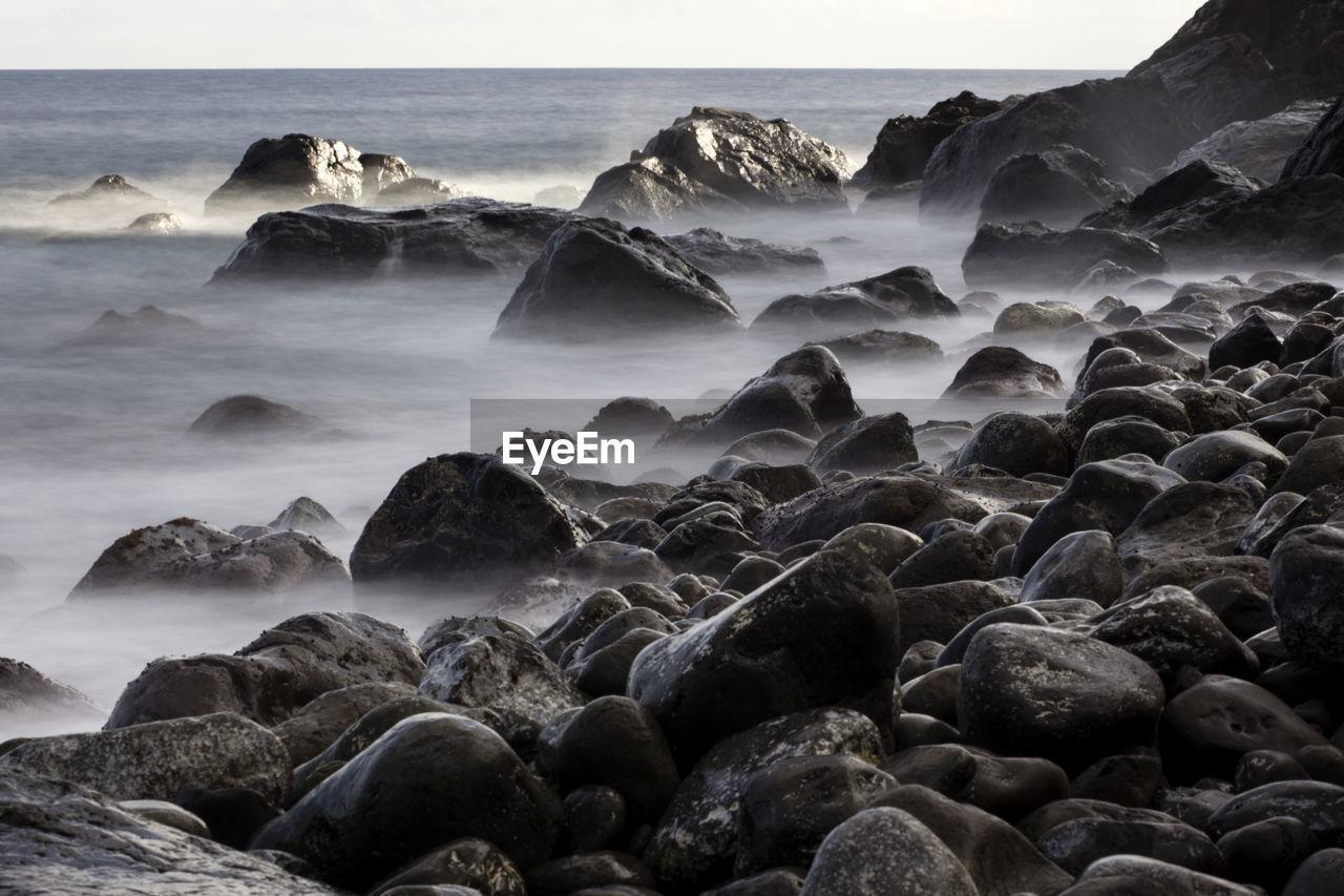 Scenic View Of Rocky Sea Shore