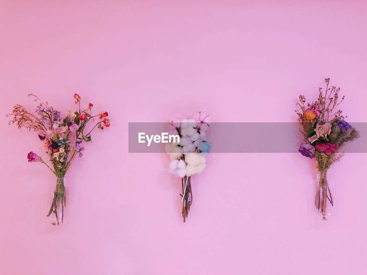 Bouquets Against Pink Wall
