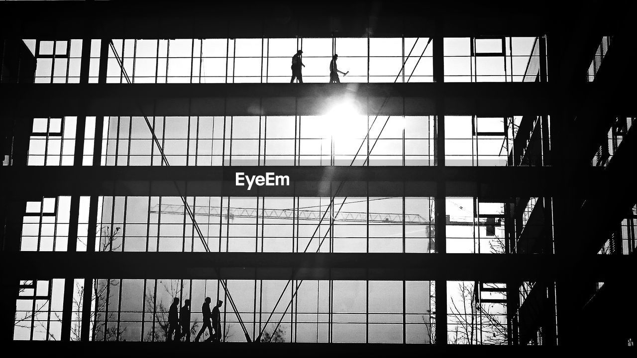Silhouette people in office building