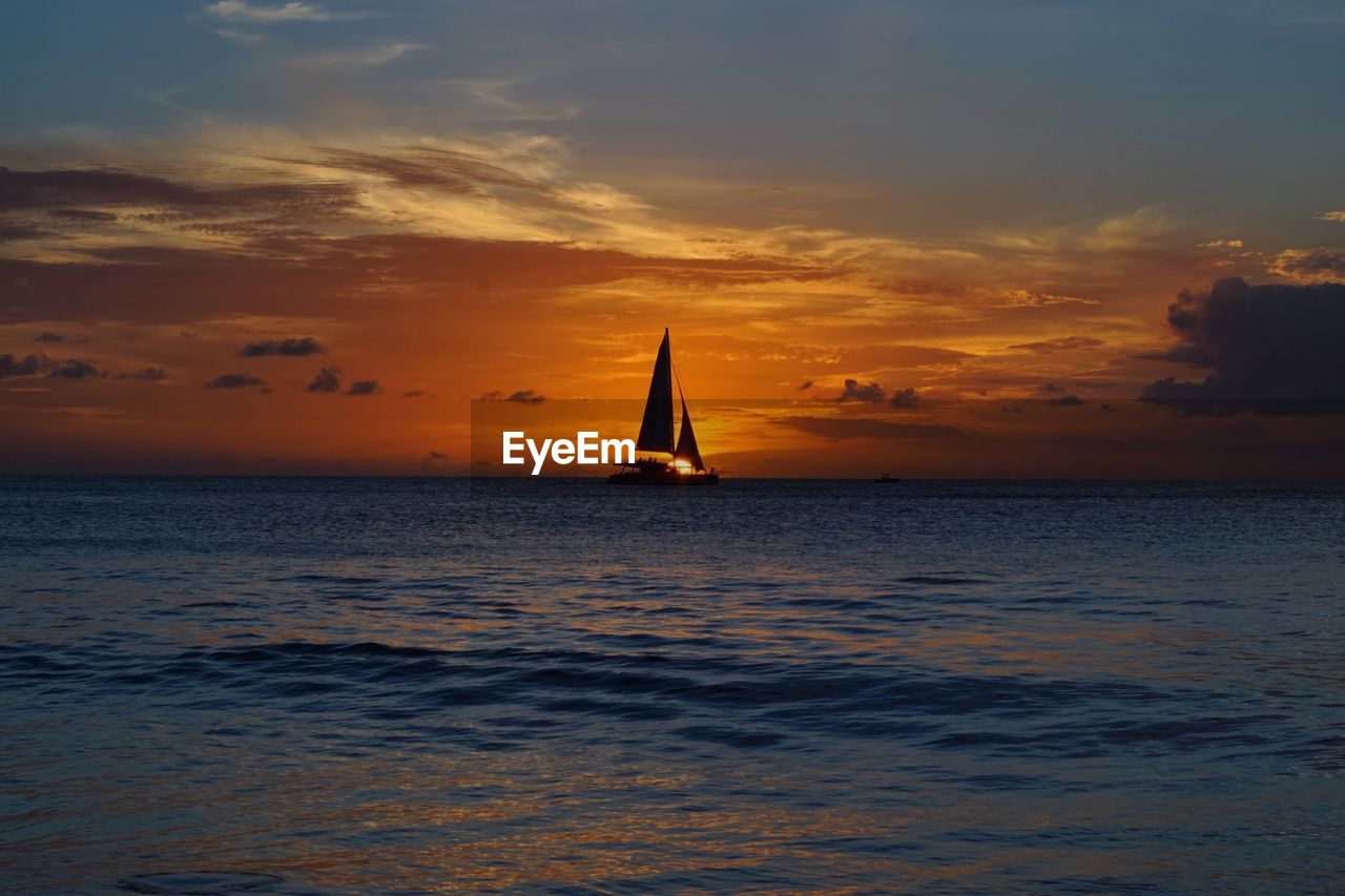 sunset, sea, sky, beauty in nature, scenics, water, cloud - sky, horizon over water, orange color, tranquility, nature, silhouette, tranquil scene, idyllic, waterfront, sailboat, nautical vessel, outdoors, no people, sailing