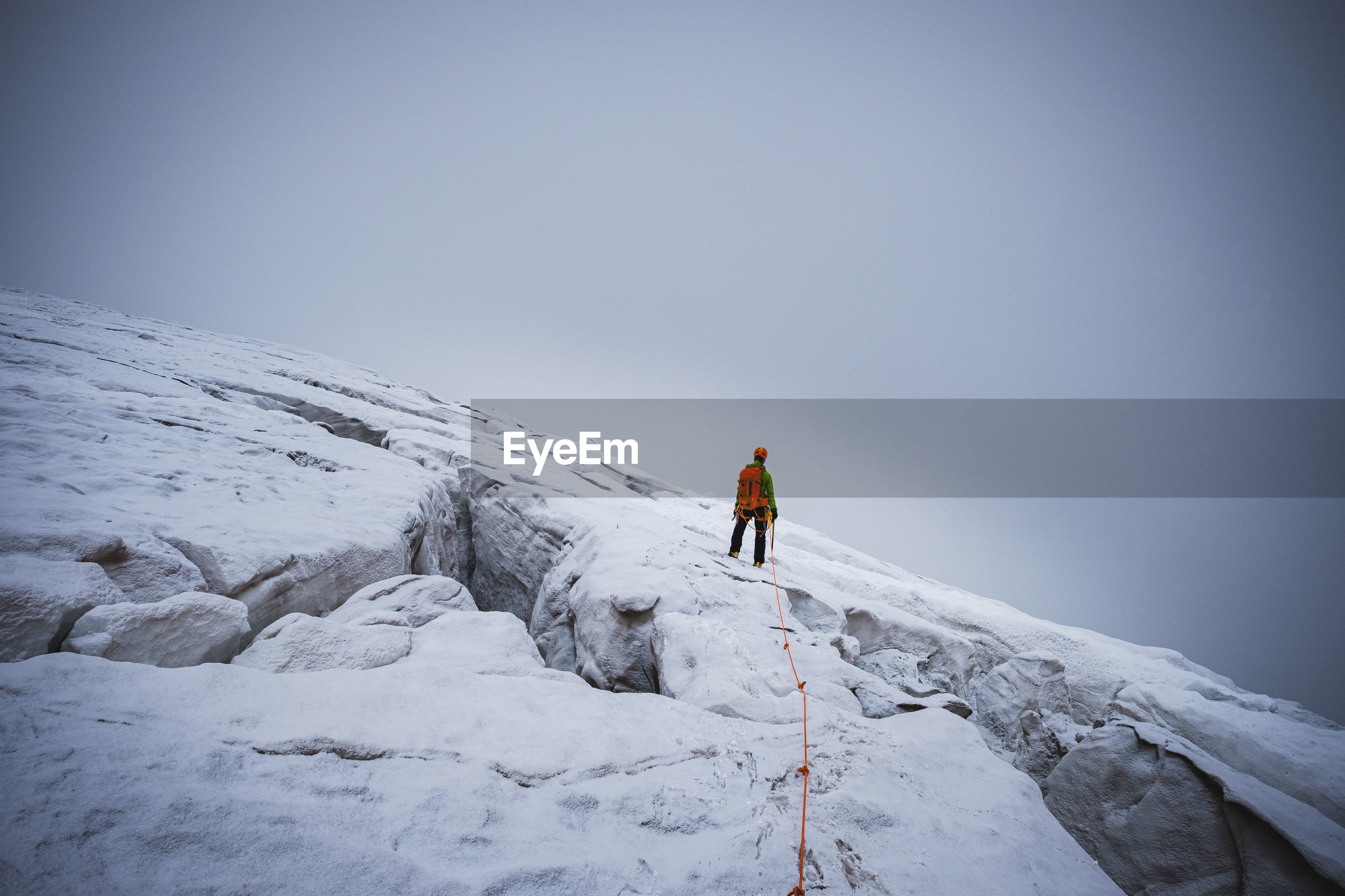 Rear view of person on glacier