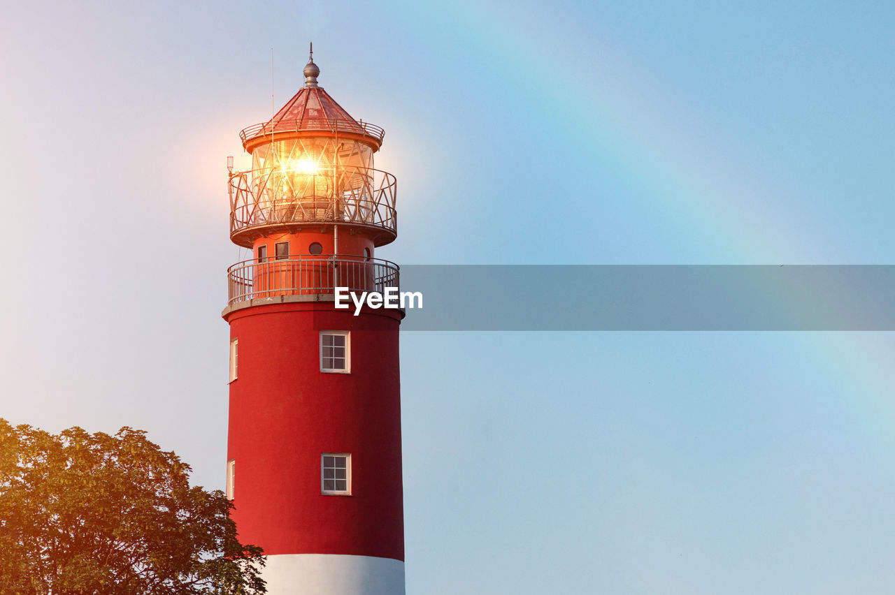 tower, building exterior, built structure, architecture, building, sky, guidance, lighthouse, low angle view, direction, no people, protection, safety, clear sky, security, nature, copy space, tall - high, red, day
