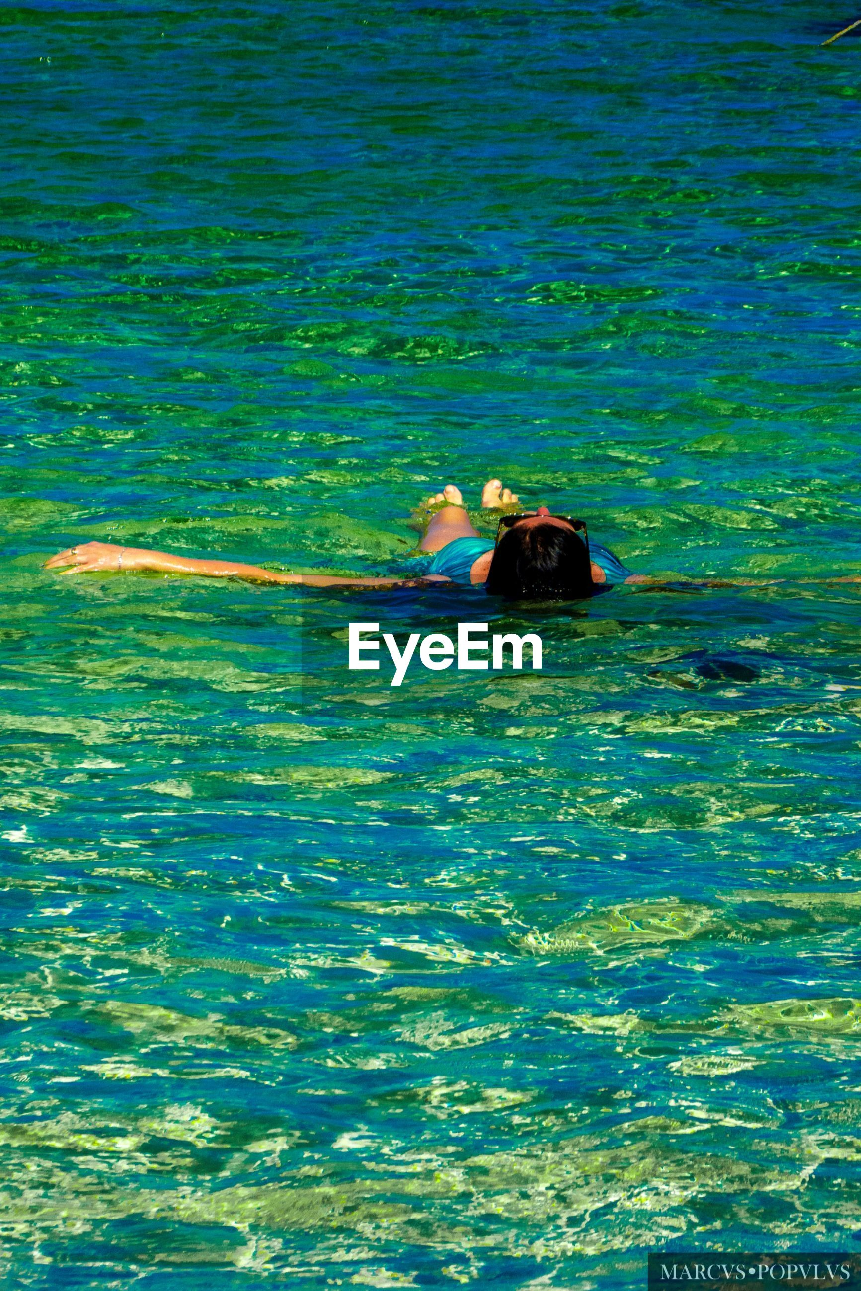 water, waterfront, real people, swimming, lifestyles, one person, leisure activity, sea, day, nature, women, adult, outdoors, blue, relaxation, trip, vacations, holiday