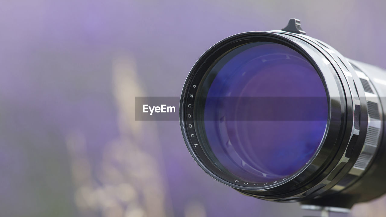 photography themes, camera - photographic equipment, technology, photographic equipment, close-up, lens - optical instrument, camera, digital camera, focus on foreground, modern, photographing, activity, shape, geometric shape, circle, single object, no people, equipment, glass - material, purple, home video camera