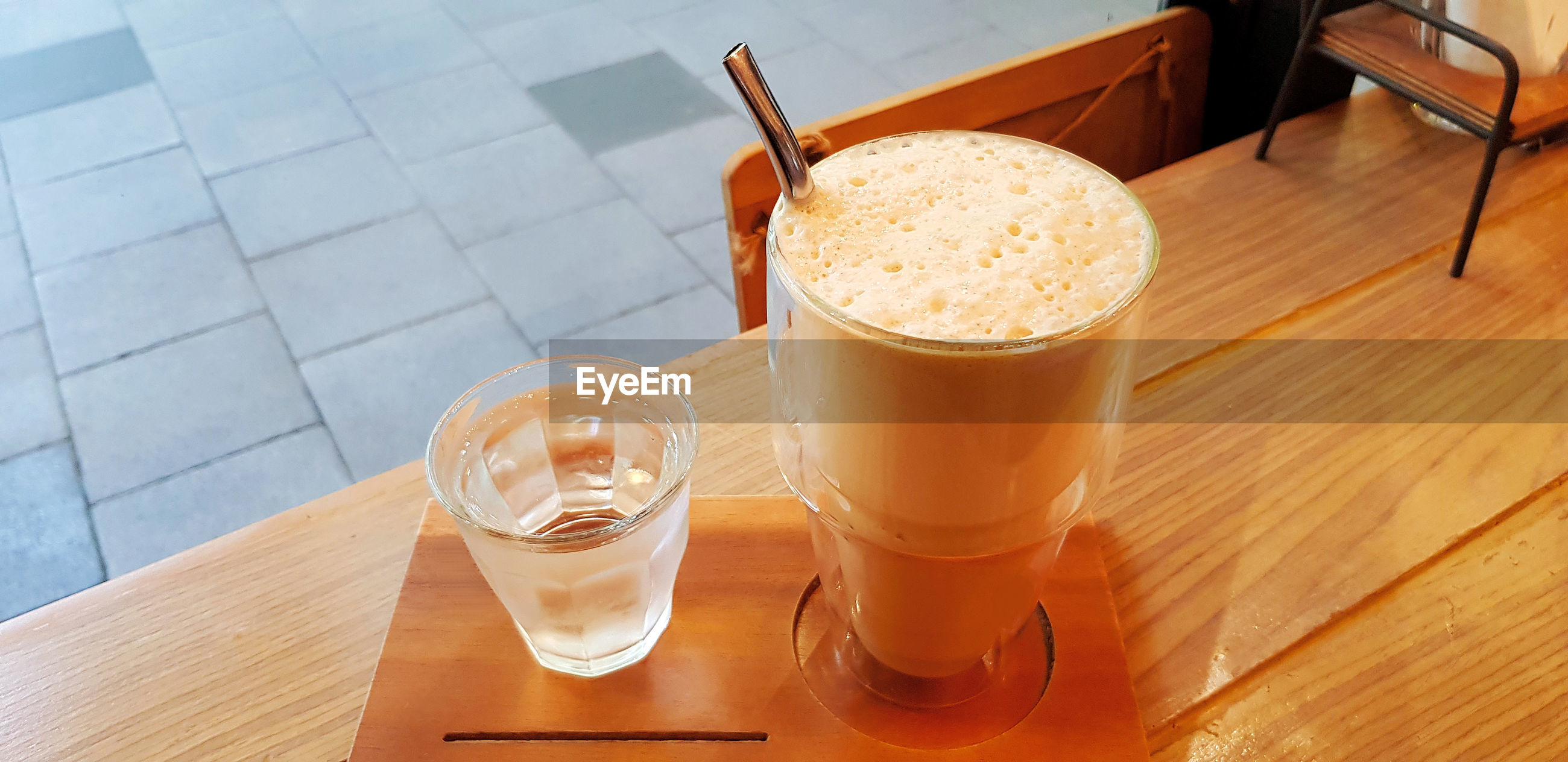 HIGH ANGLE VIEW OF COFFEE ON TABLE AT CAFE