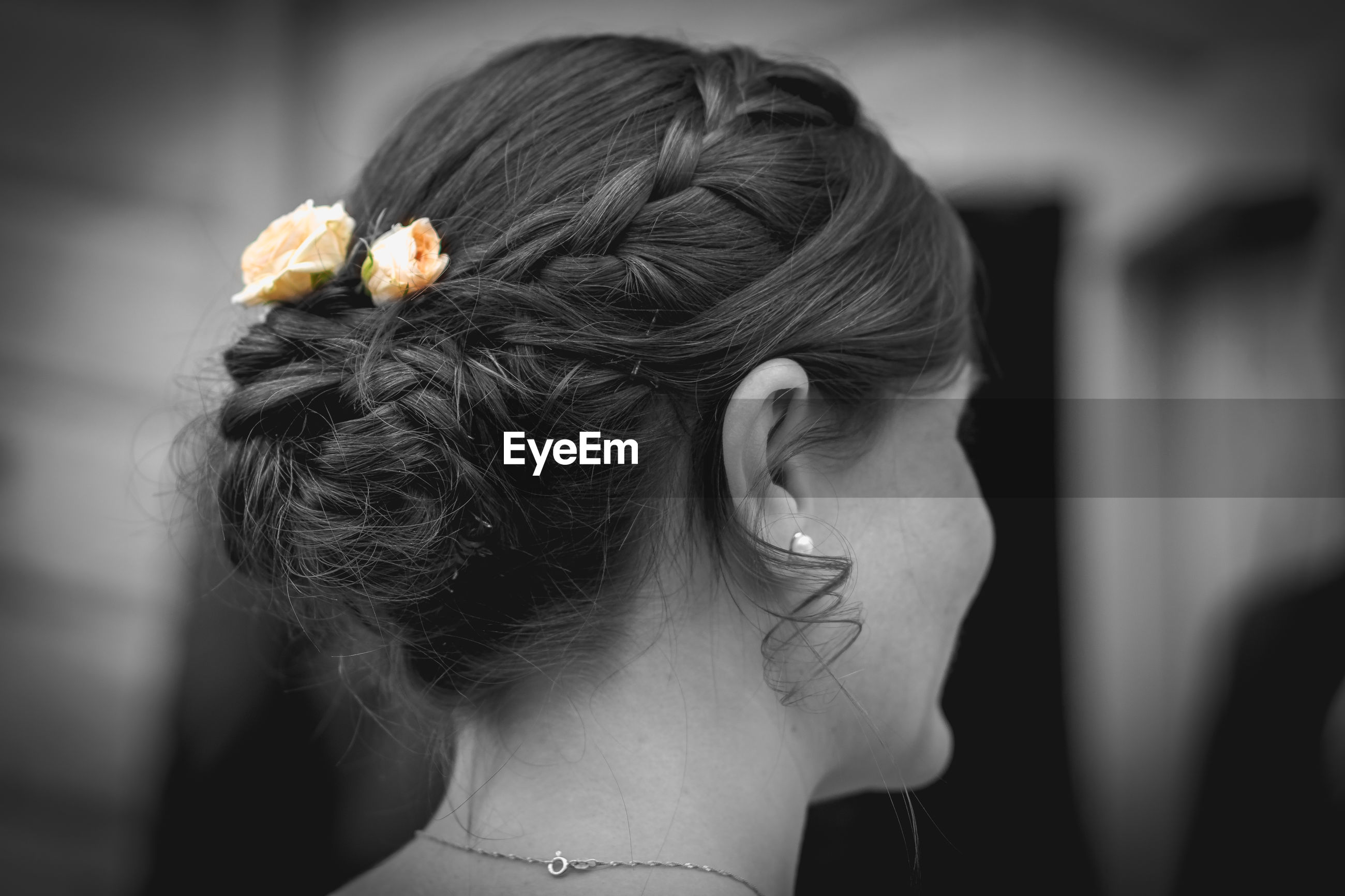 Close-up of woman wearing flowers in hair