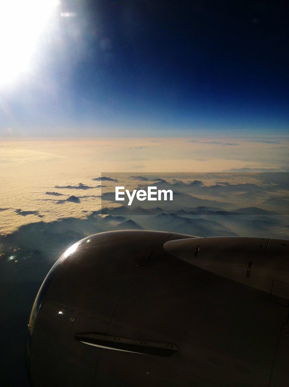 airplane, transportation, journey, air vehicle, aerial view, mode of transport, airplane wing, no people, sky, mid-air, flying, travel, beauty in nature, aircraft wing, cloud - sky, jet engine, day, outdoors, nature, scenics