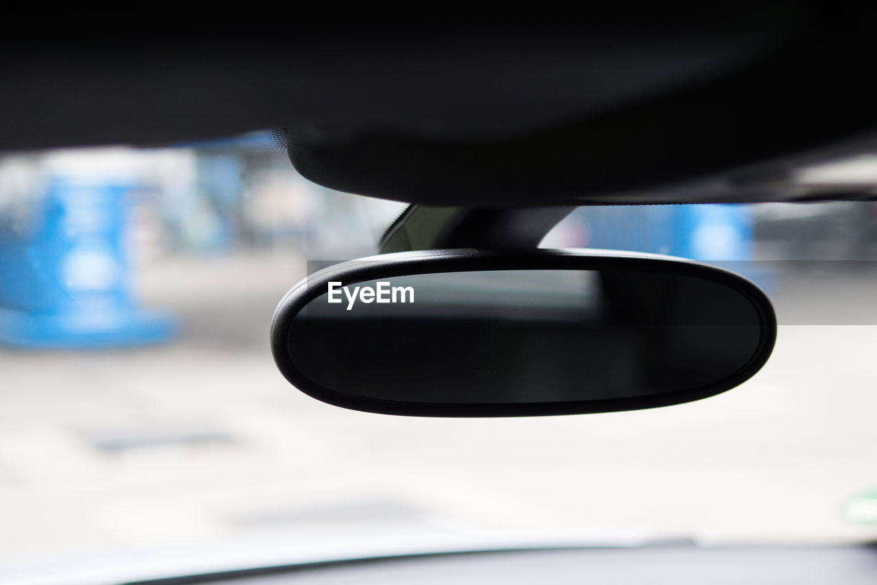 Close-up of rear-view mirror in car