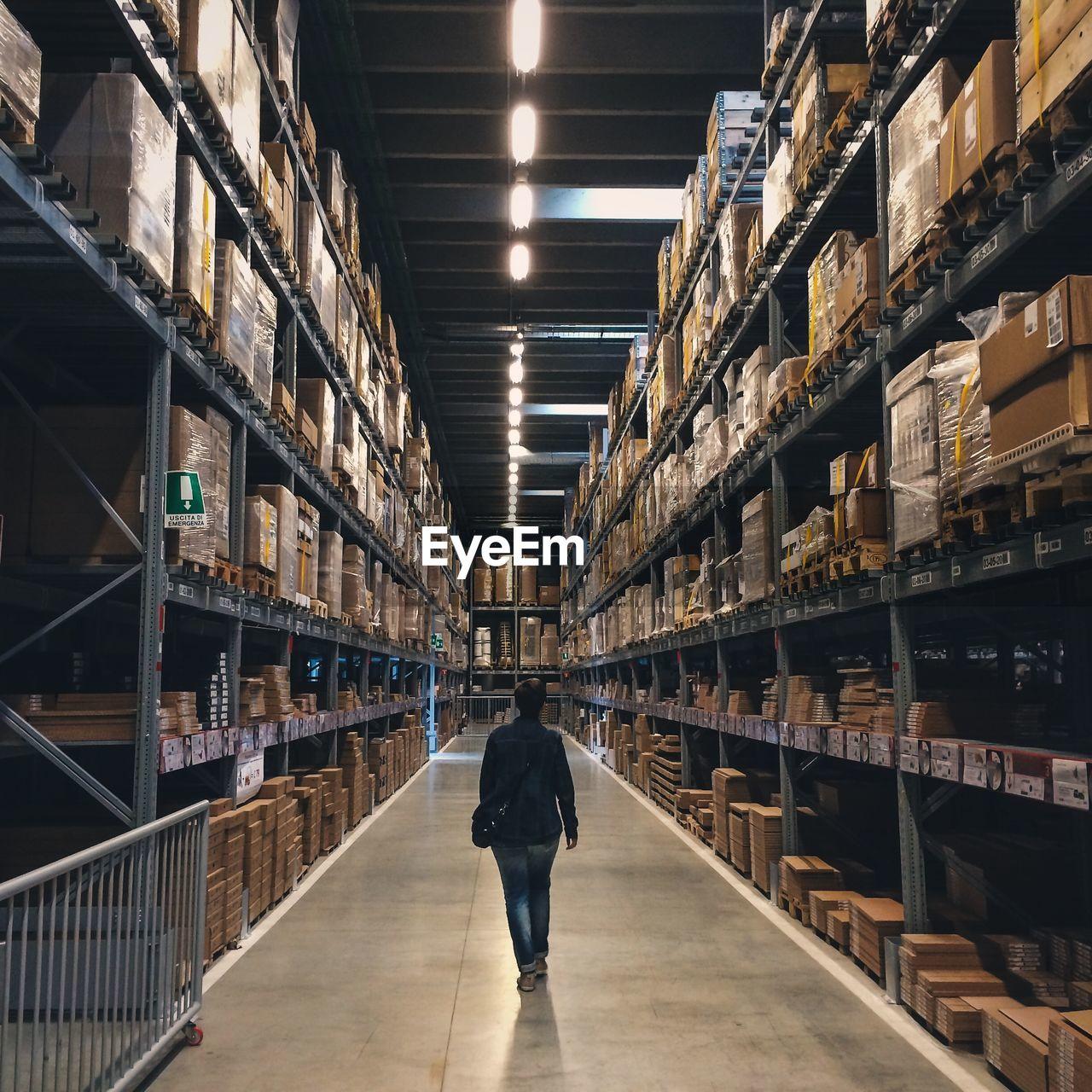 Stacked shelves on rack in warehouse