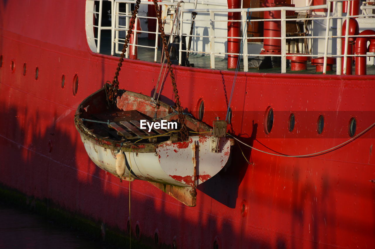 nautical vessel, red, mode of transport, moored, boat, transportation, rope, no people, outdoors, ship, harbor, day, building exterior, close-up