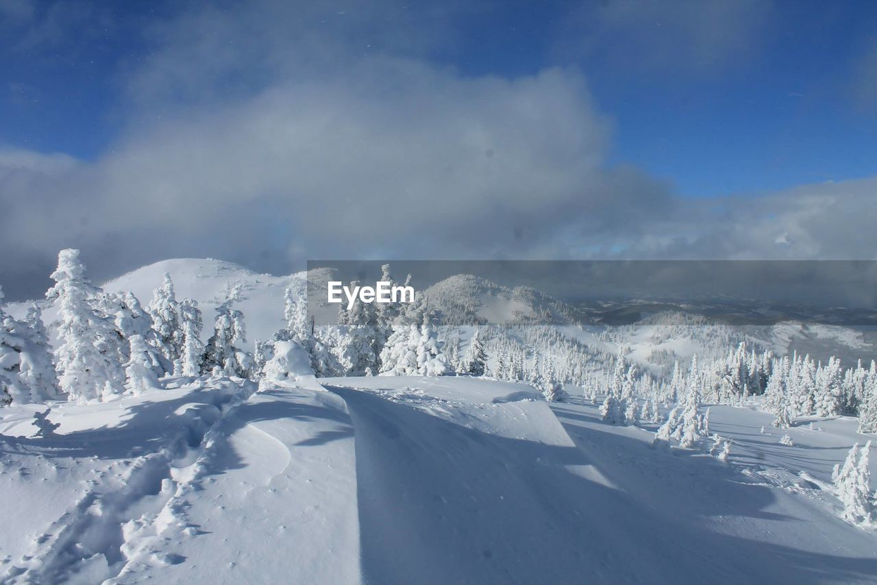 snow, cold temperature, winter, weather, nature, white color, beauty in nature, scenics, tranquility, tranquil scene, outdoors, day, no people, mountain, sky, cloud - sky, landscape