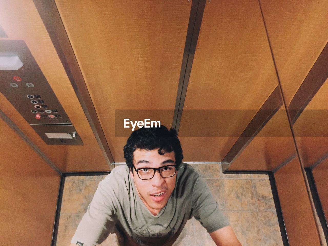 High Angle View Of Man In Elevator