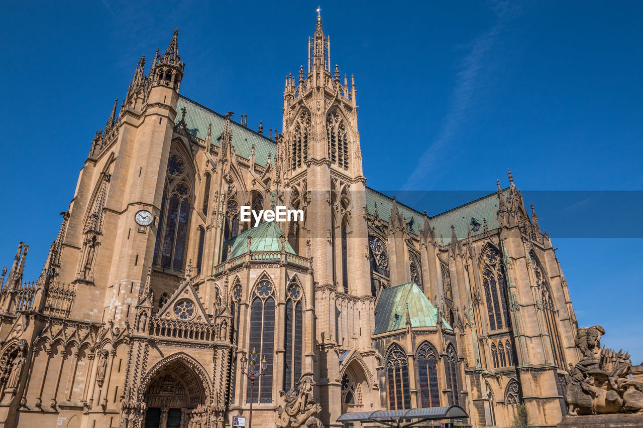 built structure, architecture, building exterior, place of worship, belief, religion, spirituality, low angle view, sky, building, travel destinations, the past, travel, history, blue, tourism, no people, gothic style, ornate, spire