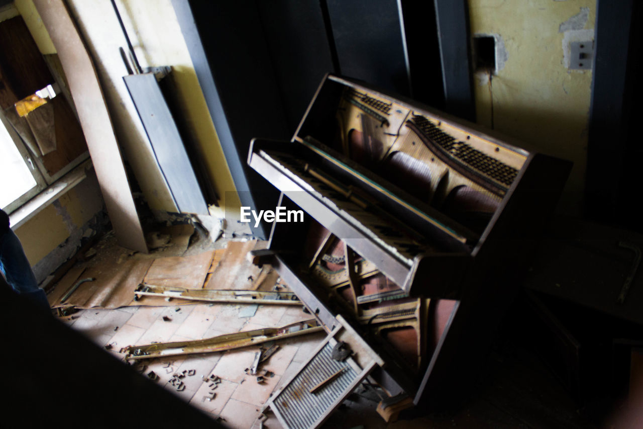 High Angle View Of Broken Piano In Abandoned Room