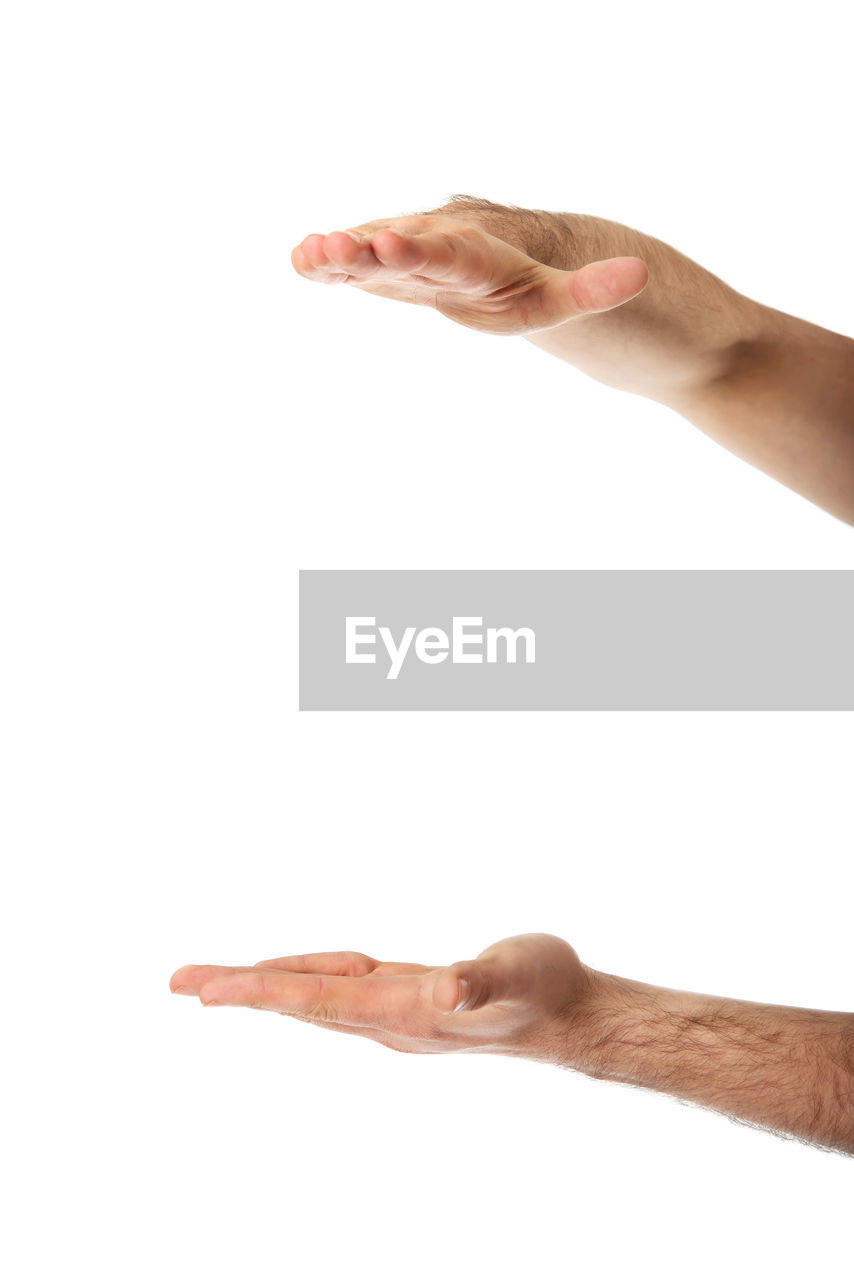 Cropped Hands Of Man Gesturing Over White Background