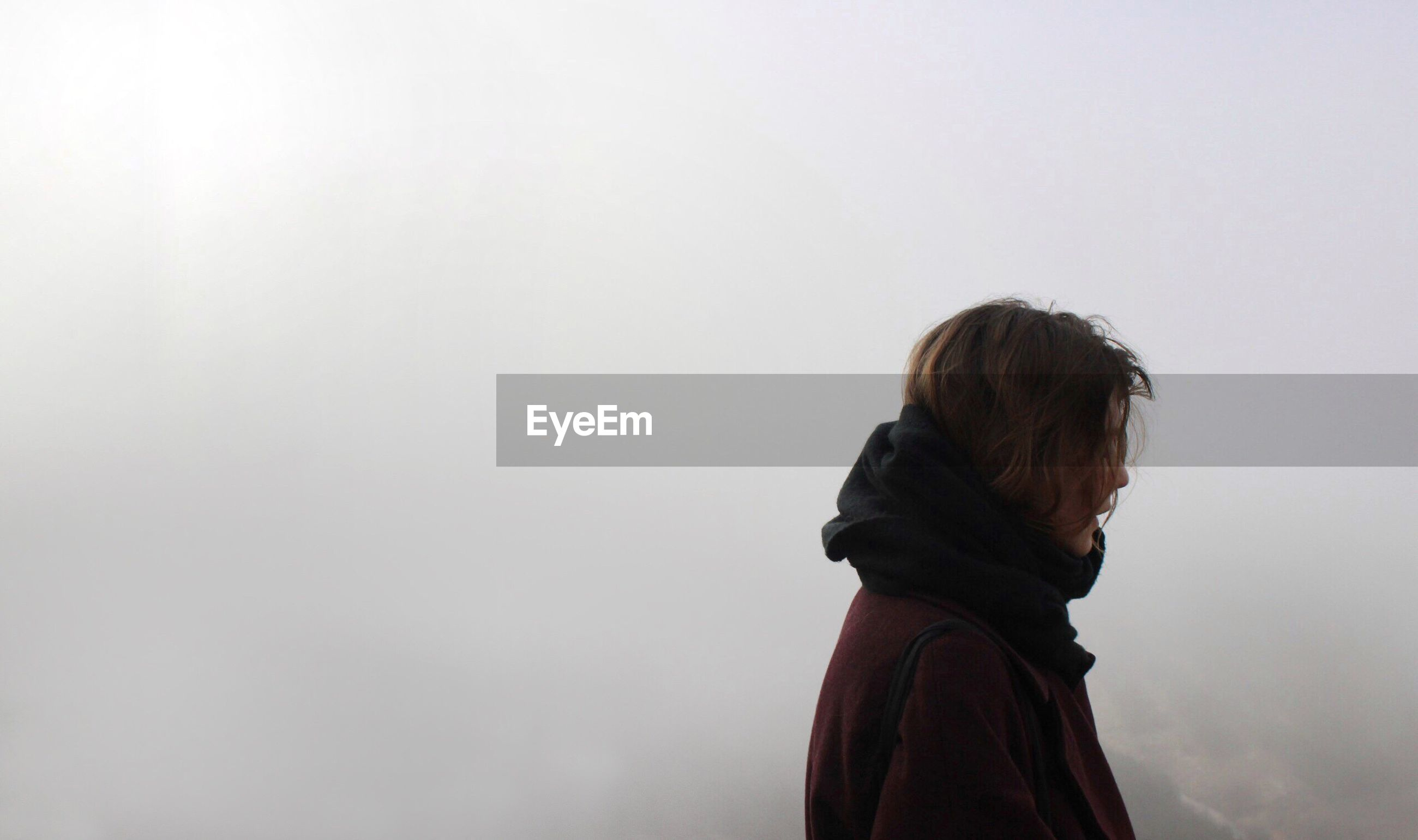 Side view of woman during foggy weather
