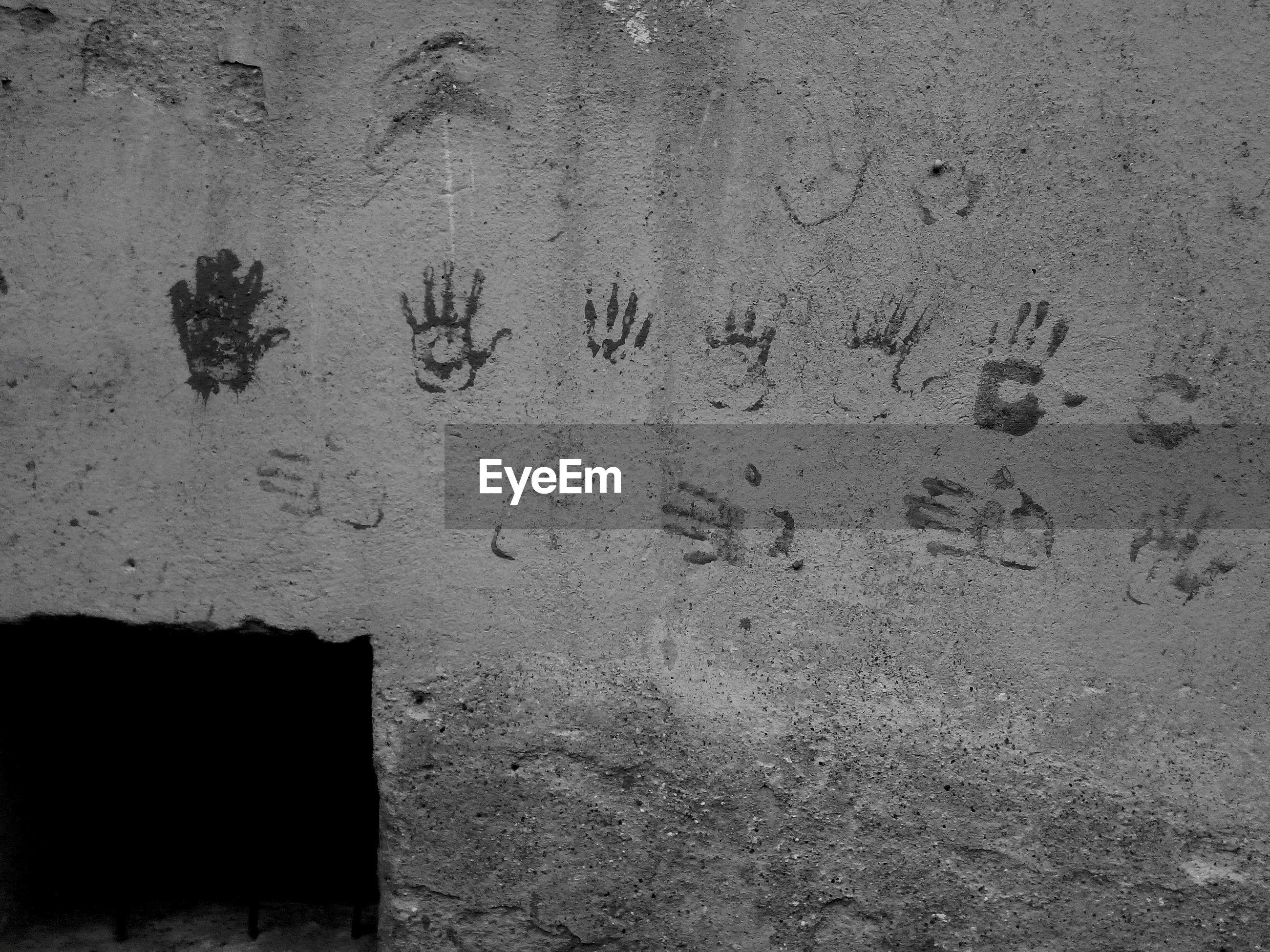 Handprints on wall