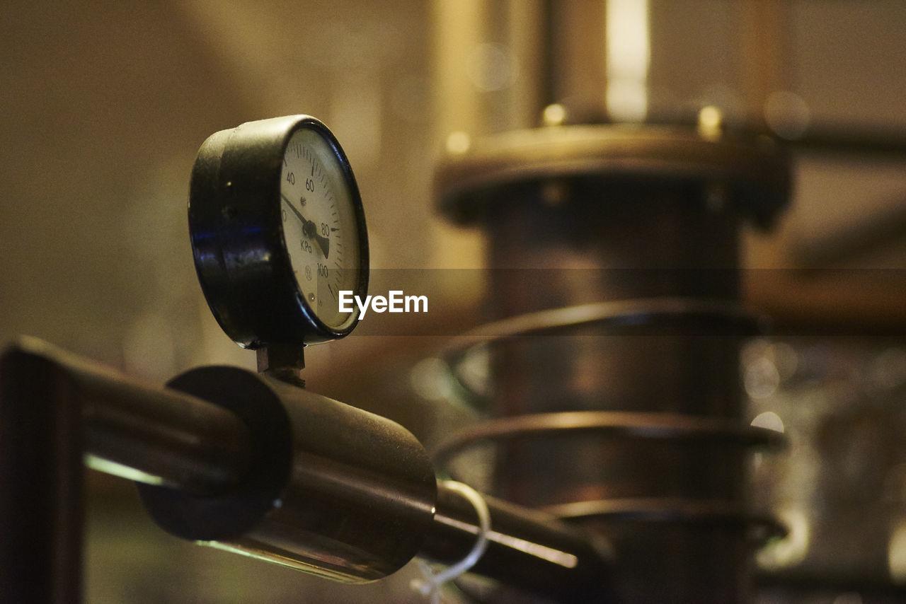 Close-up of gauge on distiller