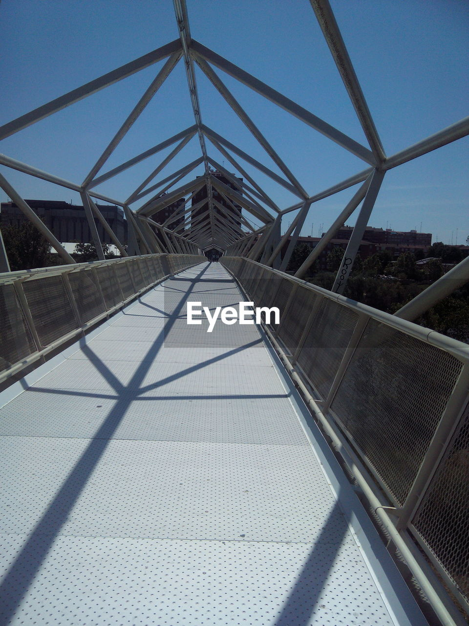 connection, day, built structure, bridge - man made structure, architecture, metal, railing, clear sky, outdoors, low angle view, sky, no people, footbridge
