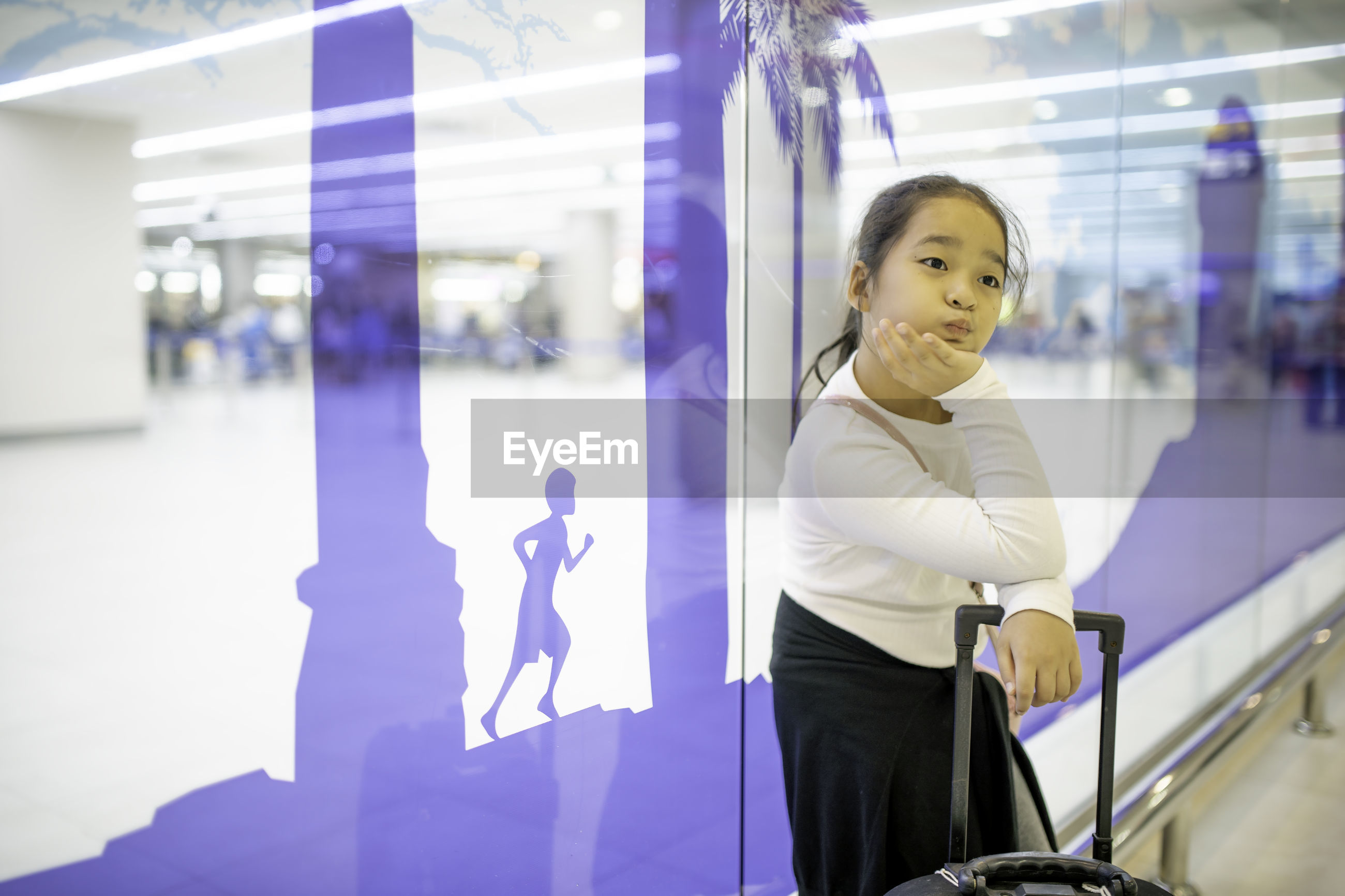 Girl standing at airport