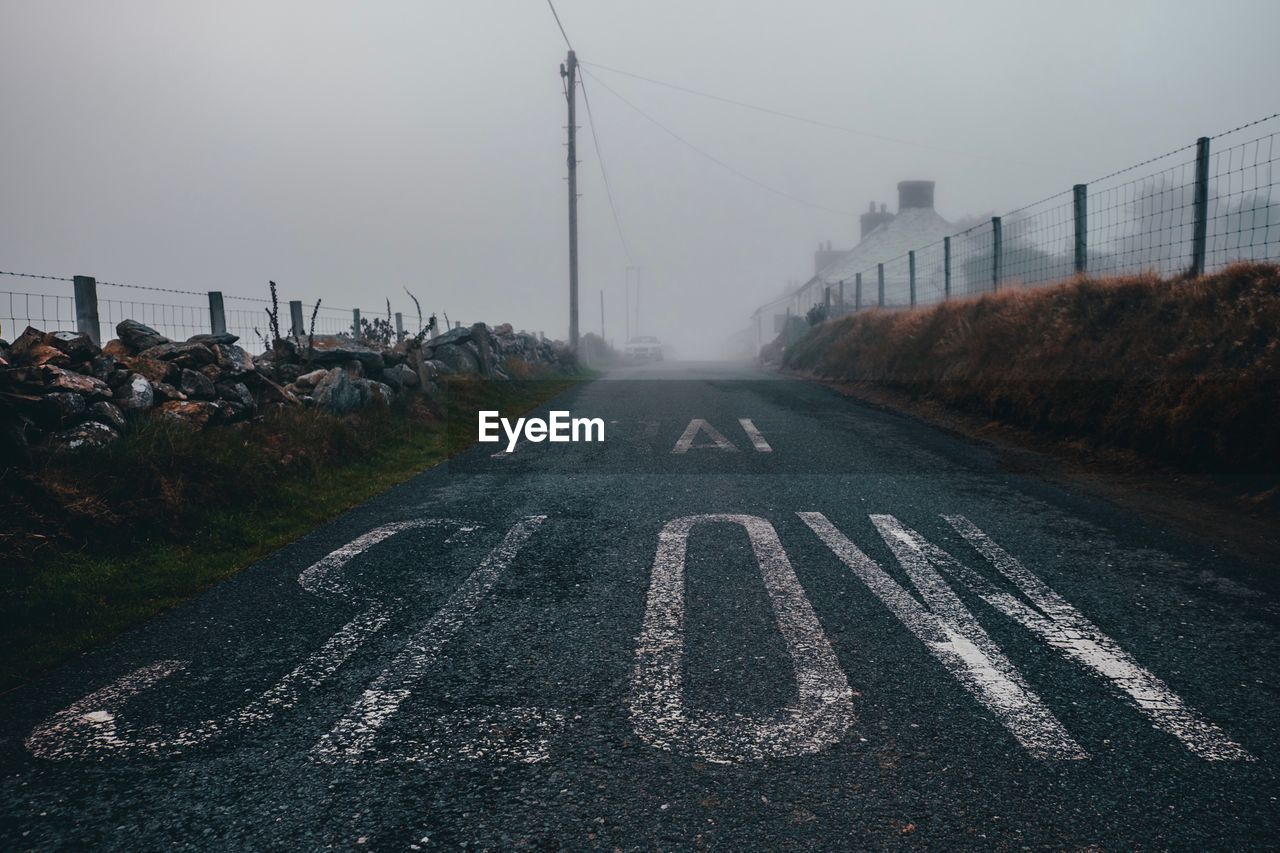 Text On Road In City During Foggy Weather