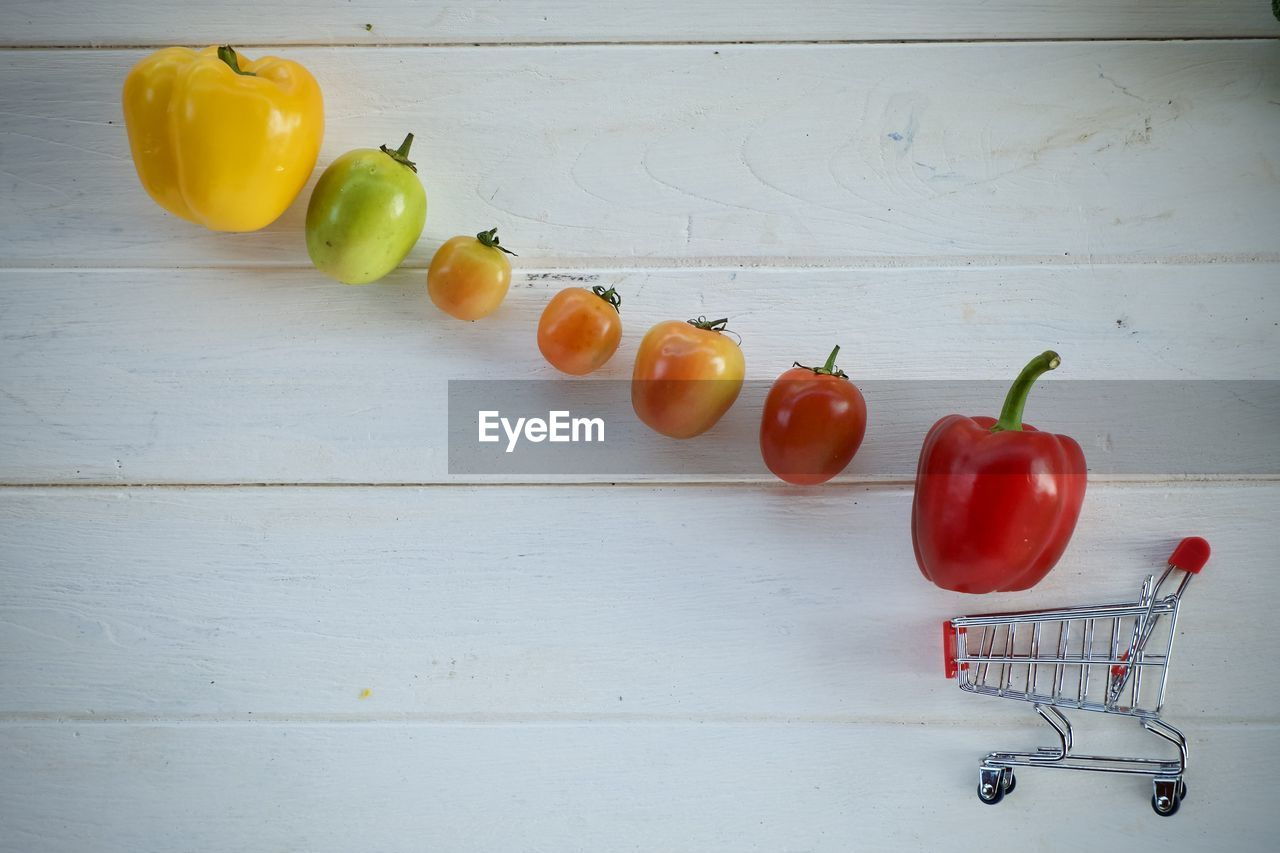 healthy eating, freshness, wellbeing, food and drink, food, fruit, table, vegetable, indoors, tomato, still life, wood - material, no people, high angle view, directly above, red, raw food, pepper, close-up, group of objects
