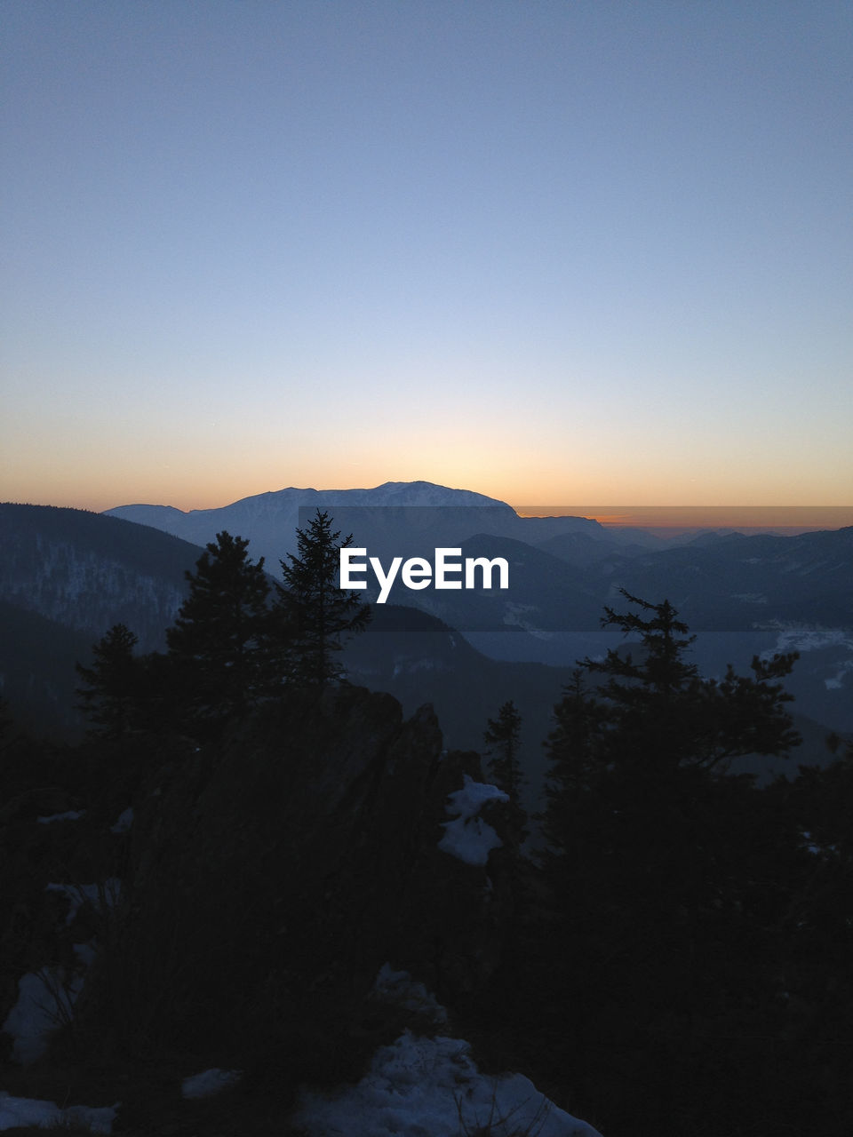 SCENIC VIEW OF MOUNTAINS AT SUNSET