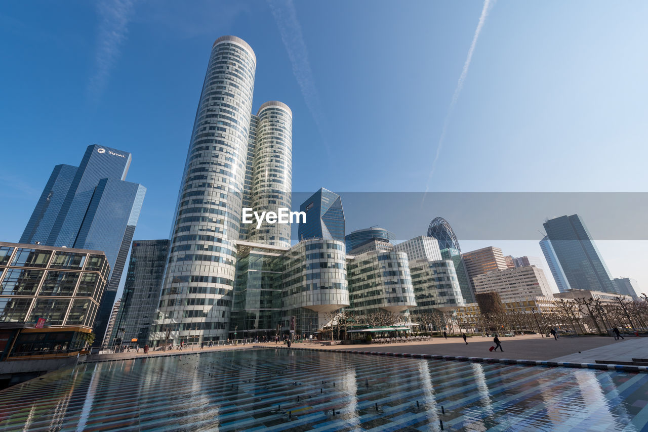 building exterior, built structure, architecture, building, water, office building exterior, city, sky, tall - high, skyscraper, nature, modern, day, no people, low angle view, tower, waterfront, office, blue, outdoors, swimming pool, financial district, luxury