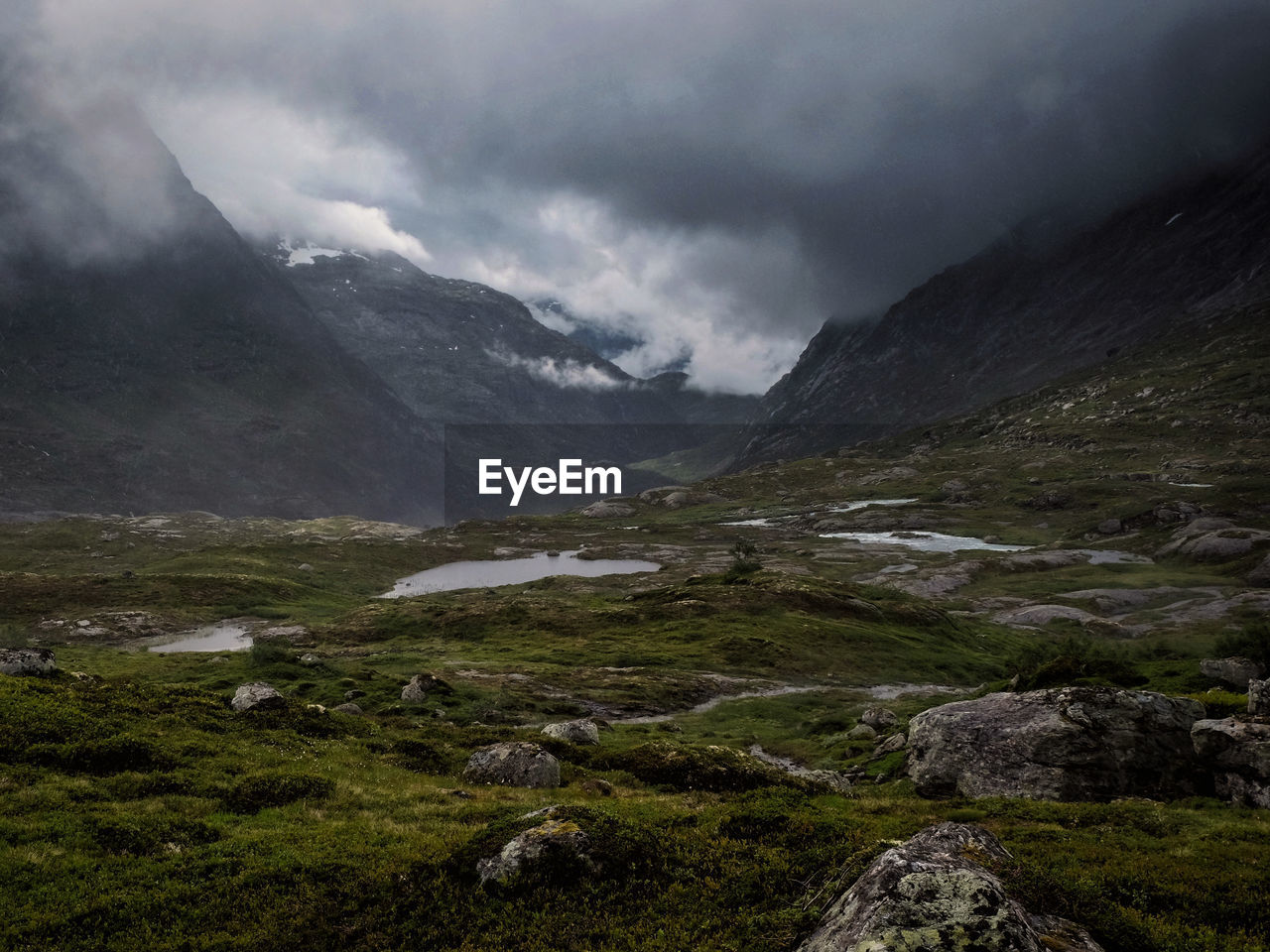 rough landscape in Breheimen National Park in Norway where you can experience barren mountains, streaming rivers, opalescent glaciers and rough untouched nature. Bad weather is normal. Breheimen National Park Norway The Great Outdoors - 2018 EyeEm Awards Beauty In Nature Clouds Environment Landscape Mountain Range Nature No People Norway Nature Outdoors Remote Scenery Scenics - Nature Valley Wilderness