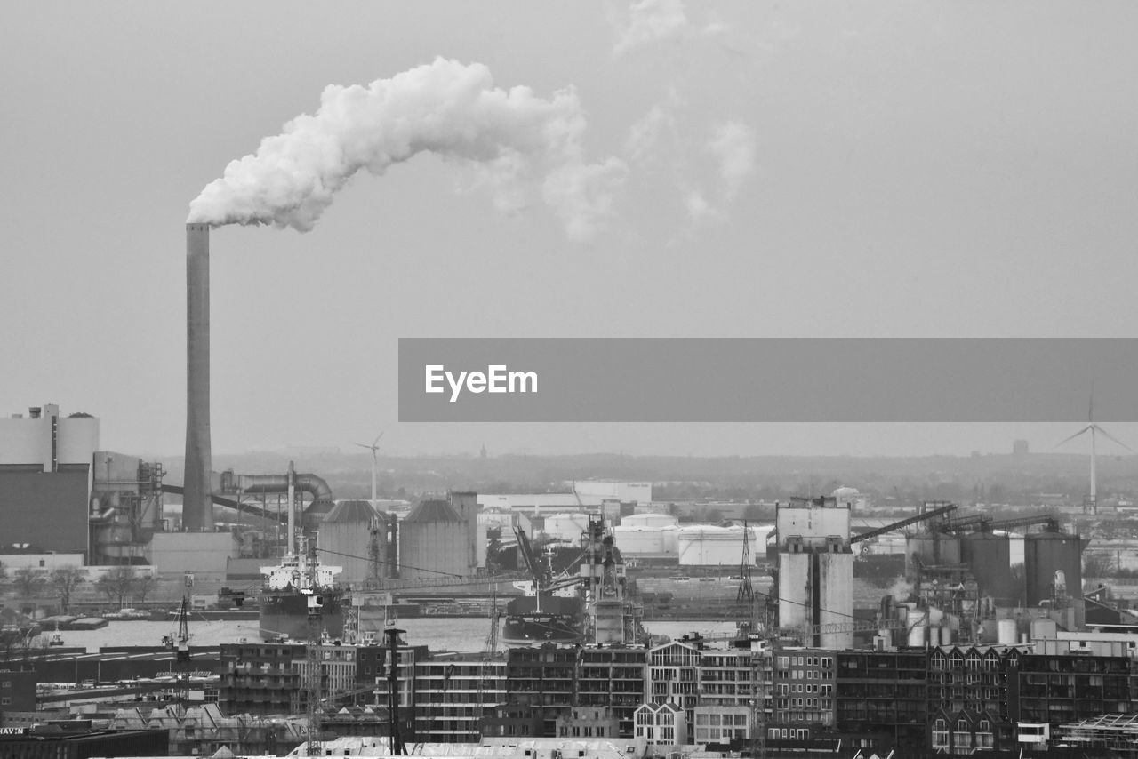 factory, industry, building exterior, pollution, smoke stack, architecture, built structure, environmental issues, smoke - physical structure, emitting, sky, chimney, environment, nature, day, air pollution, no people, outdoors, smoke, chemical, fumes, atmospheric, ecosystem, smog, industrial district