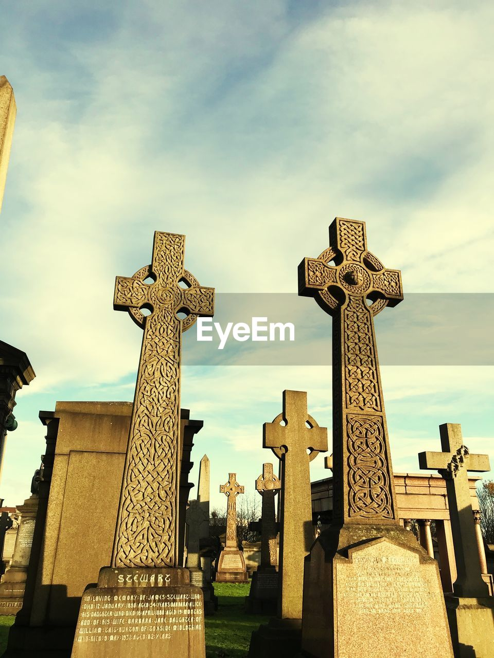 cemetery, spirituality, cross, tombstone, religion, memorial, day, cloud - sky, sky, gravestone, graveyard, outdoors, no people, low angle view