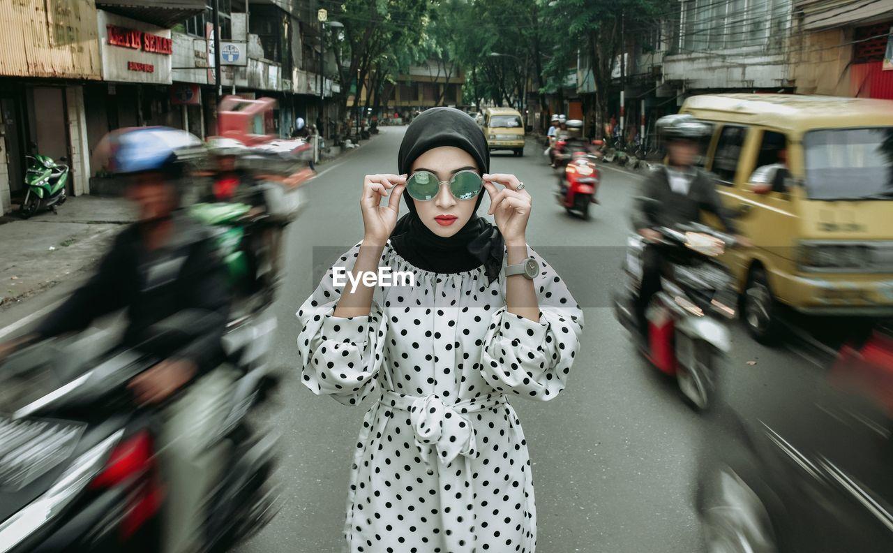 WOMAN ON STREET IN CITY