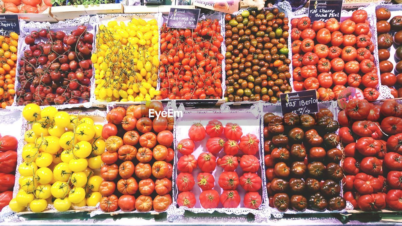Tomatoes At Market Stall