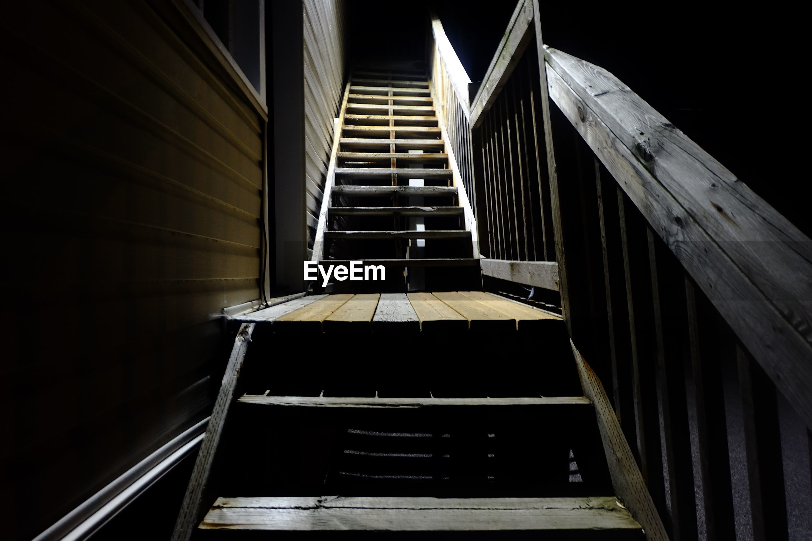 Empty steps by house at night