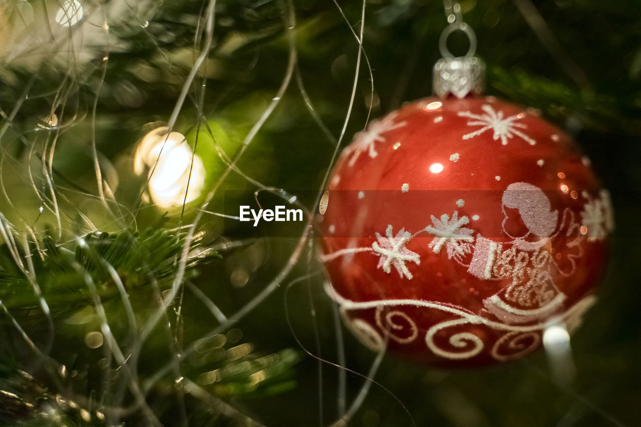 celebration, christmas decoration, holiday, christmas, decoration, christmas ornament, close-up, christmas tree, holiday - event, red, no people, event, focus on foreground, celebration event, religion, selective focus, nature, tree, outdoors